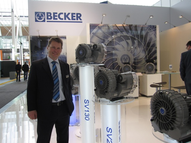 Stefan Beierlein, from Becker, next to their new line of SV side channel blowers.