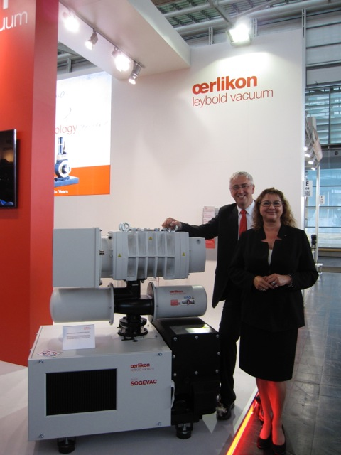 Dr. Michael Pschyrembel and Christina Steigler from Oerlikon Leybold next to their new Sogevac SV470 vacuum pump system.