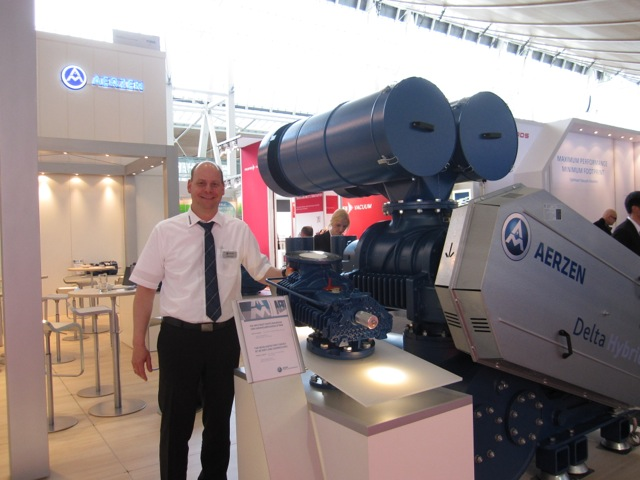Stephan Brand, from Aerzen, in front of the new Delta Hybrid rotary lobe compressor model.